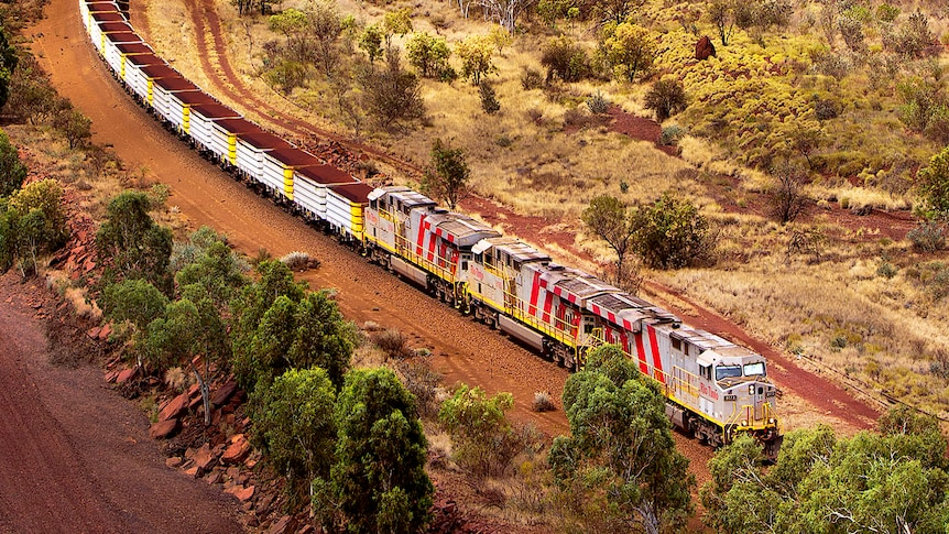 An iron ore train snakes its way through the Pilbara