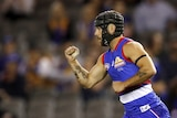 AFL player celebrates during a match