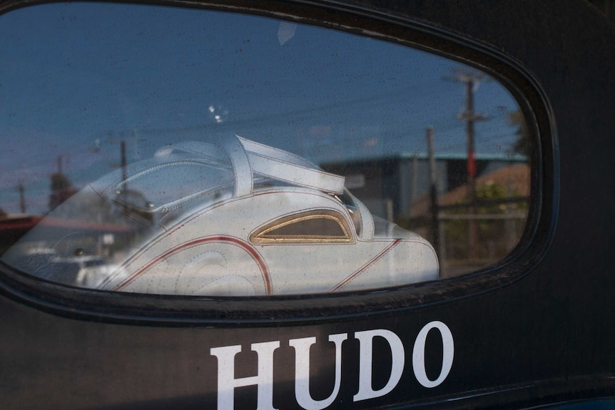 Ms Hetzer's love of automotive handbags is visible through the rear window.