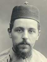 A black-and-white photo of a priest named Jozef Raskin.