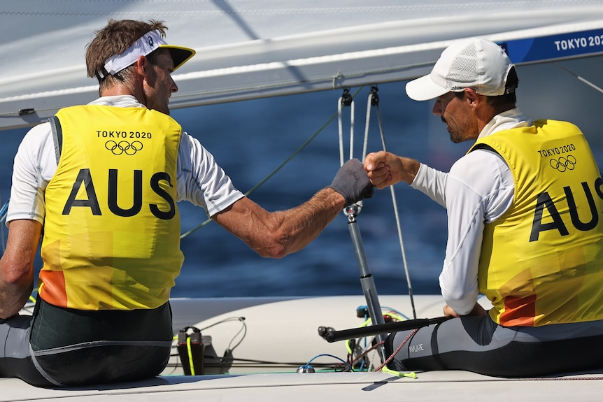 Two Australian sailors congratulate each other during their Tokyo Olympics competition.
