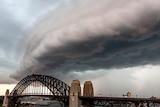 A storm cloud above the Sydney Harbour Bridge