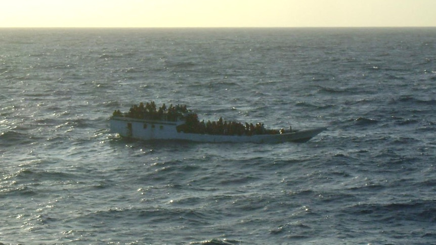 An overcrowded fishing boat, with no shelter for the asylum seekers on board, languishes in the Indian Ocean