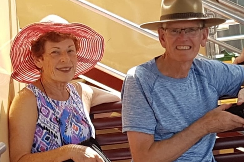 Barry and jess Roberts sitting beside each other, wearing hats, and smiling
