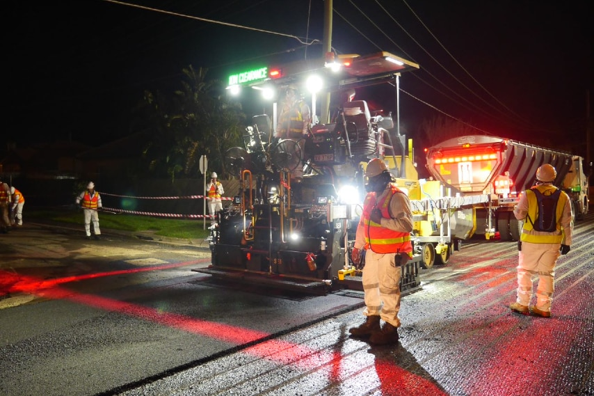 A road being resealed at night.
