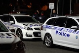 Three police cars parked outside Banksia Hill juvenile detention centre