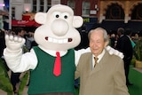 British actor Peter Sallis poses with someone dressed up as the cartoon character Wallace.