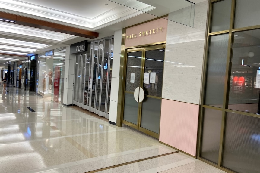 A line of shops closed in an indoor shopping mall at Indooroopilly in Brisbane.