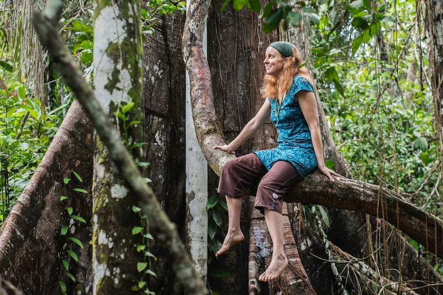 Selma Holden in an old-growth tree