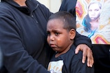 Her son cries as he is held by his mother following the verdict.