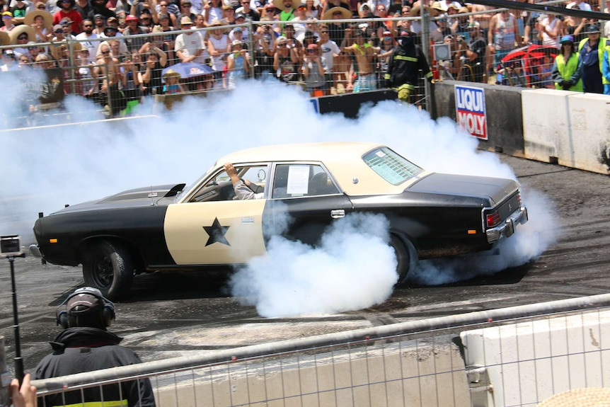 A car does a donut on the burnout pad at Summernats in Canberra.