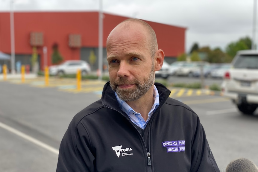 Man standing in front of testing site in Traralgon