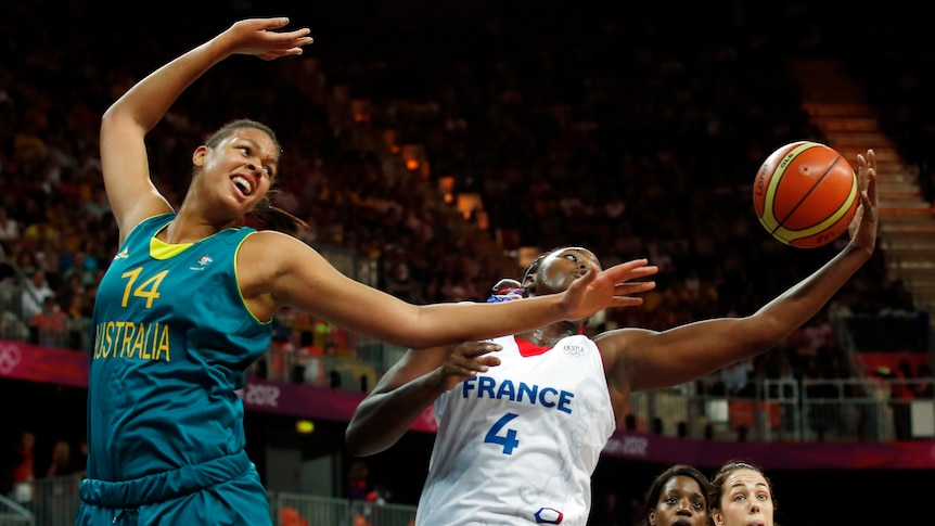 France's isabelle Yacoubou (R) grabs rebound from Australia's Liz Cambage during 2012 Olympics.
