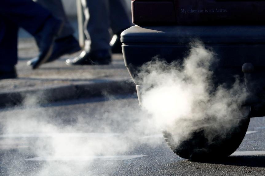 A car emits exhaust fumes