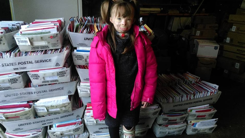 Safyre Terry with some of the thousands of Christmas cards she has received
