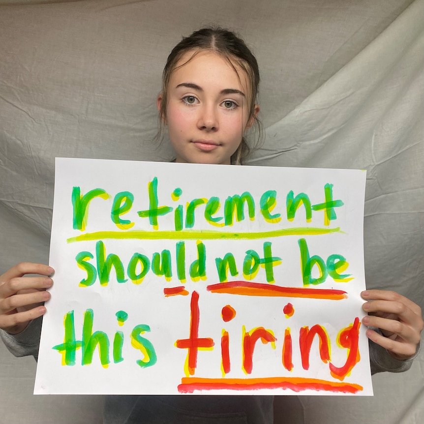 young girl holding sign saying retirement should not be this tiring