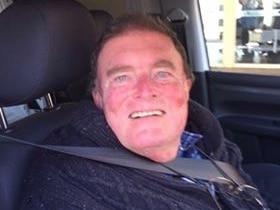 57-year-old man smiling at the camera