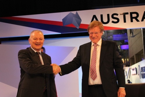 Antony Green shakes the hand of Kerry O'Brien, as both smile widely.