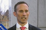 Labor Member forFraser Andrew Leigh being interviewed at Senate doors.