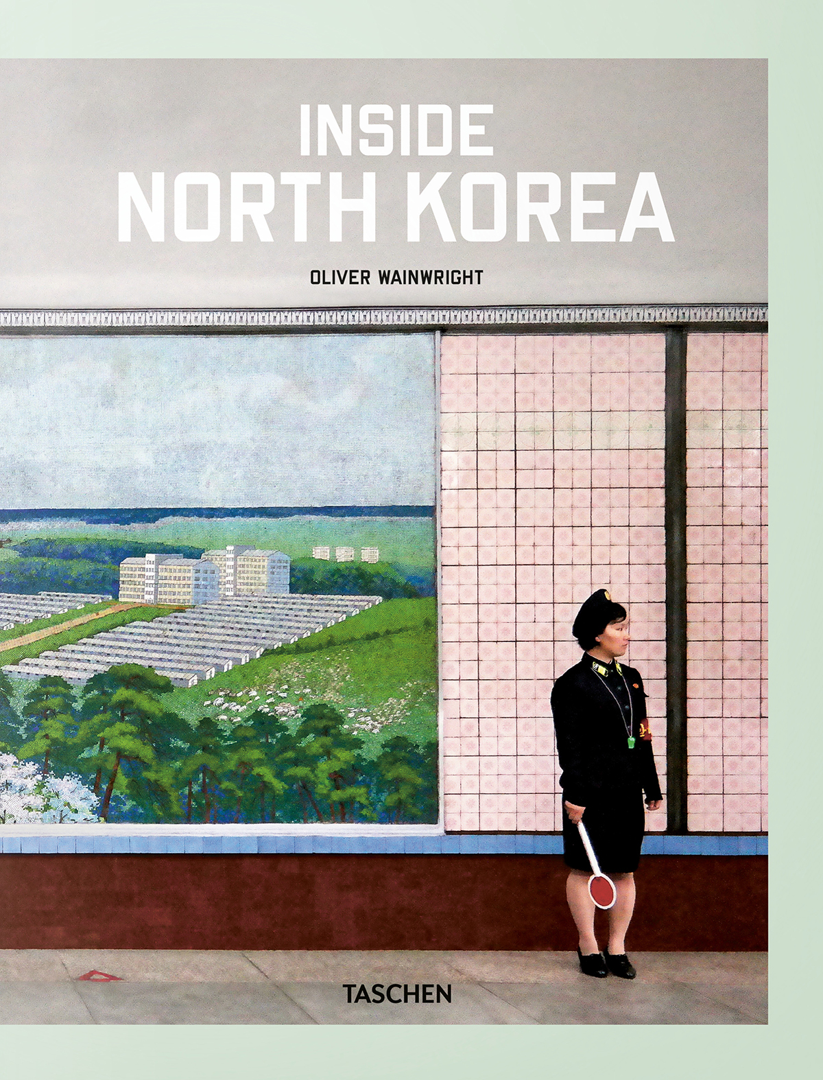 Colour scan of Insider North Korean book cover featuring a government worker standing in front of a pink tiled wall and mural.
