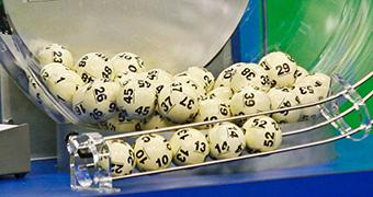 Lottery balls fall into a chute.