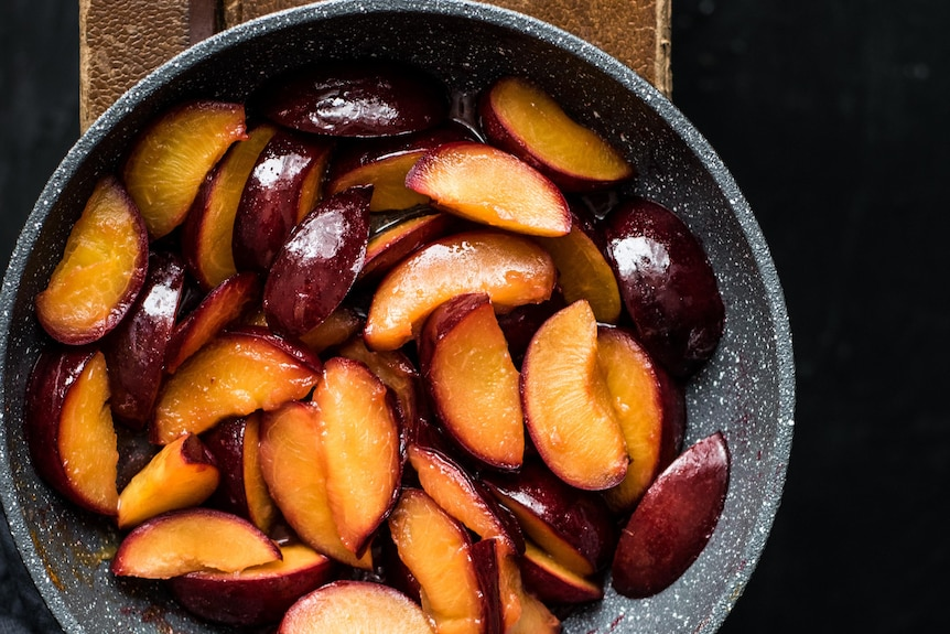 Slices of yellow plums in a bowl, ready to be eaten or cooked in summer.