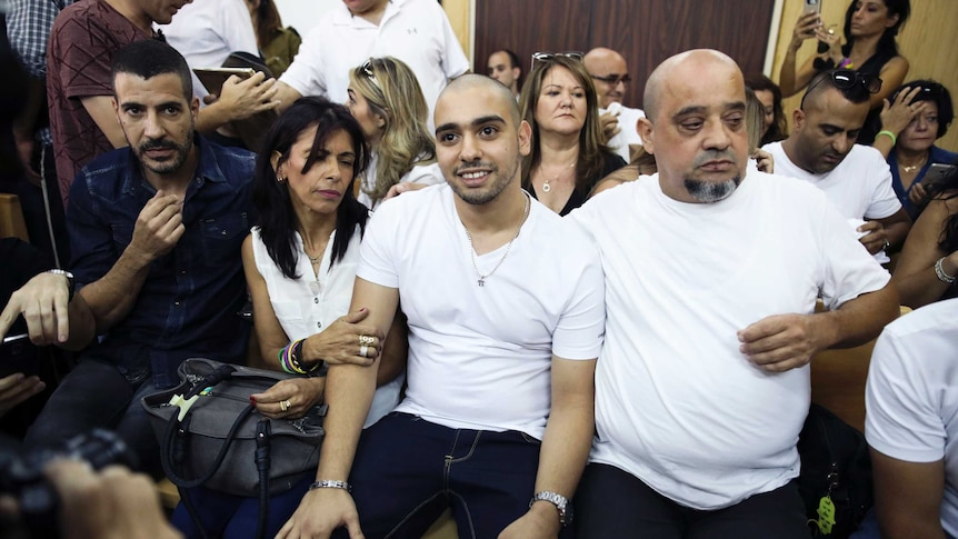 Elor Azaria (centre) sits with his parents beside him in the appeals court.