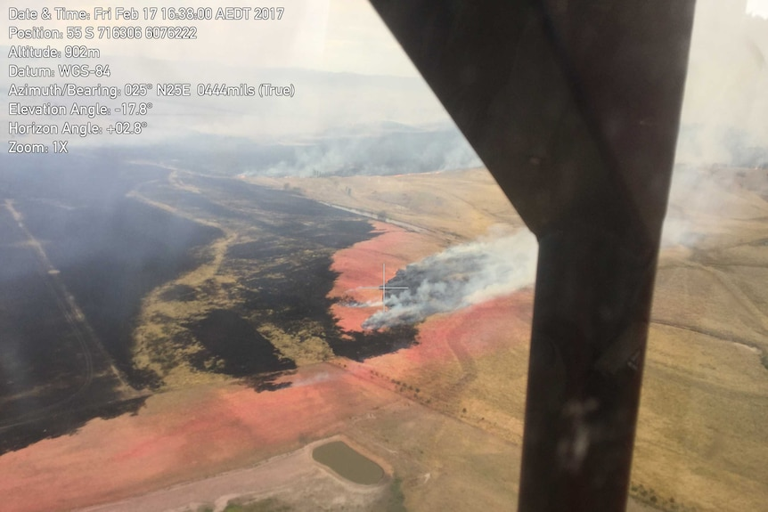 Aerial shot of the Carwoola fire from within a cockpit.