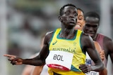 Australia's Peter Bol crosses the line ahead of French and USA runners in the 800m semi-final at the Tokyo Olympics.