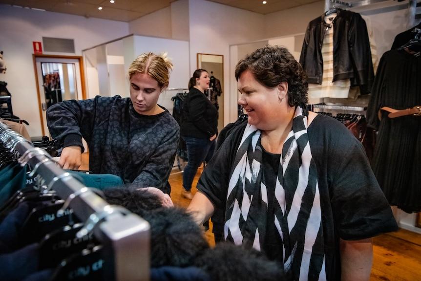 Heidi Arntzen looks through clothes racks with her daughter Emma in a shop in Bendigo..