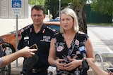 Nicole Manison and Reece Kershaw stand together at a press conference in a Darwin carpark.
