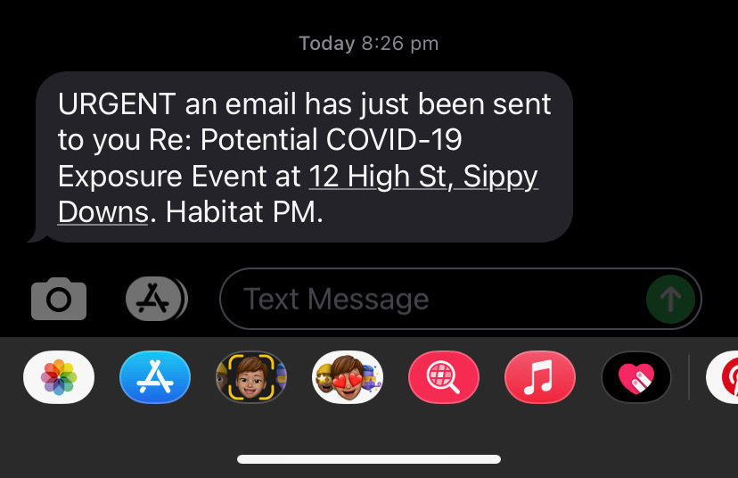 A screenshot of a text message about potential COVID-19 exposure in a Queensland apartment building.