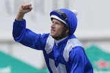 Hugh Bowman pumps his right fist as returns Winx to scale at Royal Randwick.