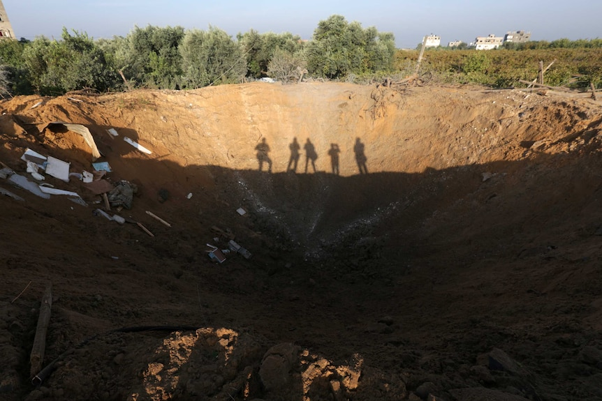 The crater left by an Israeli retaliatory air strike that demolished the house of a Palestinian family.