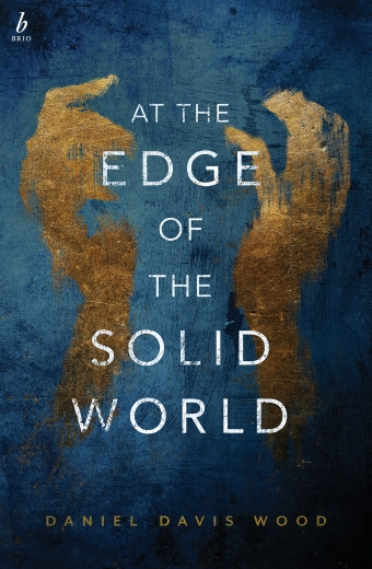 The book cover of At the Edge of the Solid World by Daniel Davis Wood, two abstractly painted hands grasp at the book's title