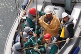 Rescued: sixty-year-old survivor Hiromitsu Shinkawa with Japan Maritime Self-Defence Force crew.