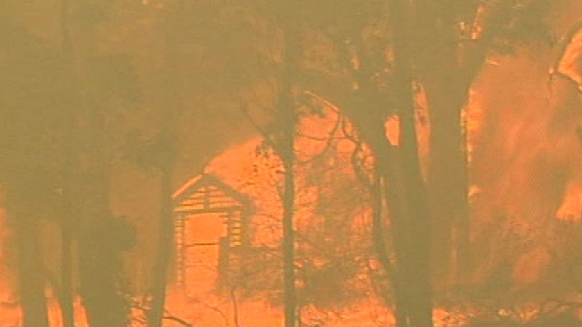 A house engulfed in flames during the Black Saturday bushfires.