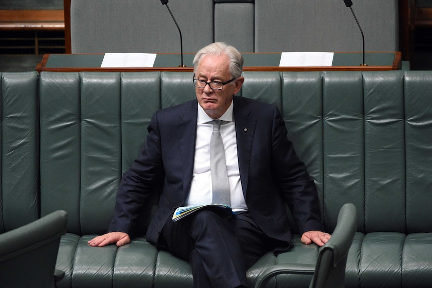 Andrew Robb sits on the bench in parliament