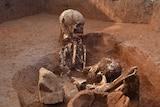 Bones in a grave at the Plain of Jars in Laos.