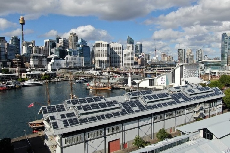 Aerial shot of the Australian National Maritime Museum, and its rooftop solar panels, at Darling Harbour, Sydney.