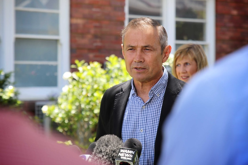 Health Minister Roger Cook stands at a press conference in front of King Edward Memorial Hospital.