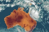 Storm surges and wild seas are expected and a cyclone watch now extends south to Hervey Bay.