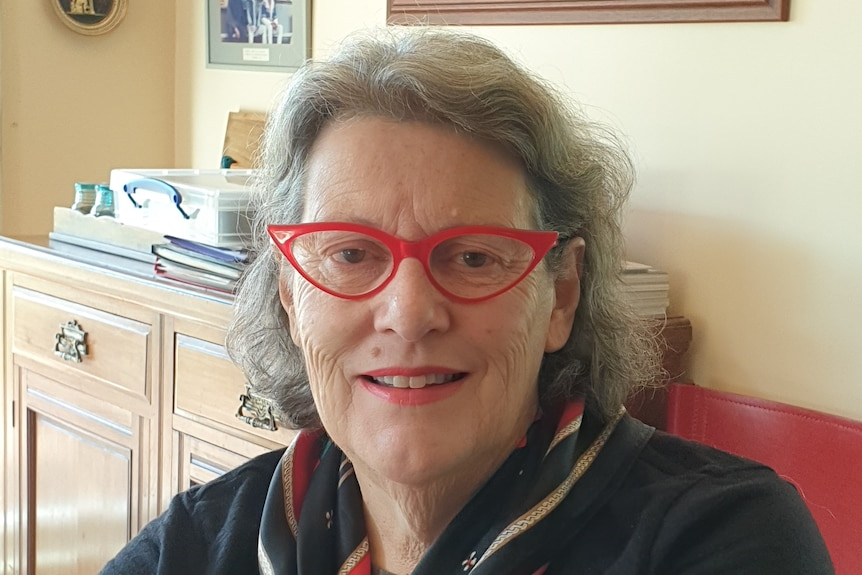 Smiling woman wearing red glasses