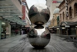 Two silver balls and an empty pedestrian mall