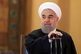 Iranian President Hassan Rouhani prepares to speak during a press conference.