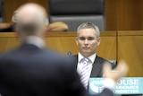 Labor backbencher Craig Thomson listens to RBA governor Glenn Stevens in Canberra on February 19, 2010.
