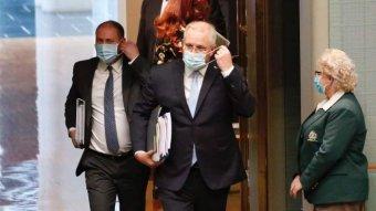 Scott Morrison and Josh Frydenberg enter the House of Representatives wearing face masks.