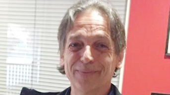 A man smiling into the camera