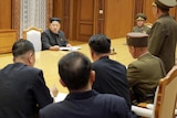 Kim Jong-un at an emergency meeting of the Workers' Party of Korea Central Military Commission.