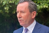 A head and shoulders shot of WA Premier Mark McGowan speaking in a media conference outdoors.